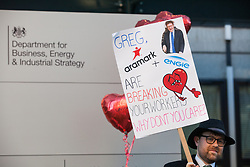 London, UK. 14th February, 2019. Outsourced support staff from the Public & Commercial Services (PCS) union stand with colleagues and fellow trade union members on a Valentine's Day-themed picket line outside the Department of Business, Energy and Industrial Strategy (BEIS) during strike action to demand the London Living Wage and an end to outsourcing.