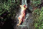 Woman in Waterfall, Hawaii, USA<br />