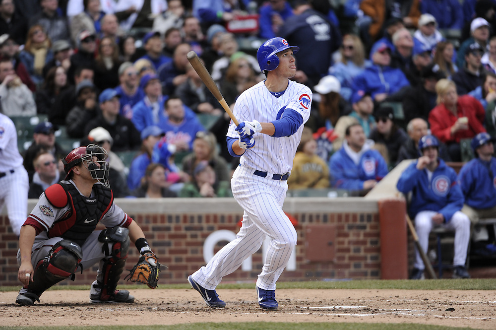 CHICAGO - APRIL  05:  Tyler Colvin #21 of the Chicago Cubs hits a two-run home run in the third inning against the Arizona Diamondbacks on April 5, 2011 at Wrigley Field in Chicago, Illinois.  The Cubs defeated the Diamondbacks 6-5.  (Photo by Ron Vesely) Subject: Tyler Colvin