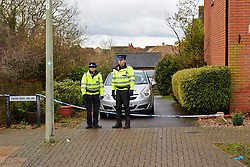 © Licensed to London News Pictures.  03/12/2012. BICESTER, UK. Police Community Support Officers (PCSO) guard the scene of a murder in Lucerne Aveneue, Bicester. 31 year old Janee Parsons was found with multiple stab wounds on Saturday (1st Dec) morning and later died in hospital. A 38-year-old man has been arrested on suspicion of murder and is currently in police custody. Photo credit :  Cliff Hide/LNP