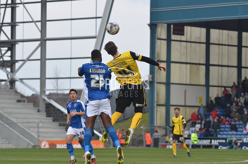 Genseric Kusunga goes up against  George Waring during the Sky Bet League 1 match between Oldham Athletic and Barnsley at Boundary Park, Oldham, England on 14 March 2015. Photo by Mark Pollitt.