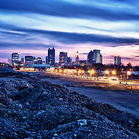 Photo of Columbus Ohio skyline at dusk. Shot from the North side.<br /> <br /> This image is available as a limited addition print. <br /> It is printed on aluminum and is 18&quot; X 24&quot;. <br /> Each print of 10 will be individually numbered and signed by the artist.