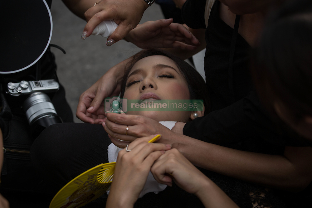 October 22, 2016 - Bangkok, Bangkok, Thailand - A woman lose consciousness due to the heat as mourners perform the Royal Anthem at Sanam Luang in Bangkok, Thailand on October 22, 2016. More than 100.000 mourners from across Thailand came during the long week end holiday to sing the Thai Royal Anthem to pay respect to the late Thailand King Bhumibol Adulyadej who passed away on October 13, 2016 at Siriraj Hospital. Thai King Bhumibol Adulyadej was the world's longest reigning monarch and died at the age of 88 after a long illness since several years, he was the most unifying symbol for Thai people and leaving behind him a divided country under military control. (Credit Image: © Guillaume Payen/NurPhoto via ZUMA Press)