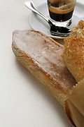 Slices of fresh baked bread with a cup of espresso