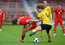 WREXHAM, WALES - Friday, September 6, 2019: Wales' Mark Harris (L) and Belgium's captain Wout Faes during the UEFA Under-21 Championship Italy 2019 Qualifying Group 9 match between Wales and Belgium at the Racecourse Ground. (Pic by Laura Malkin/Propaganda)