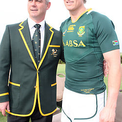 DURBAN, SOUTH AFRICA - JUNE 08, Springbok coach Heyneke Meyer with Jean de Villiers during the South African national rugby team photograph at Southern Sun Beverley Hill Hotel on June 08, 2012 in Durban, South Africa<br /> Photo by Steve Haag / Gallo Images