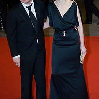 LONDON - FEBRUARY 10: Celebrity Chef Jamie Oliver and wife arrives  at the Orange British Academy Film Awards at the Royal Opera House on February 10, 2008 in London, England.