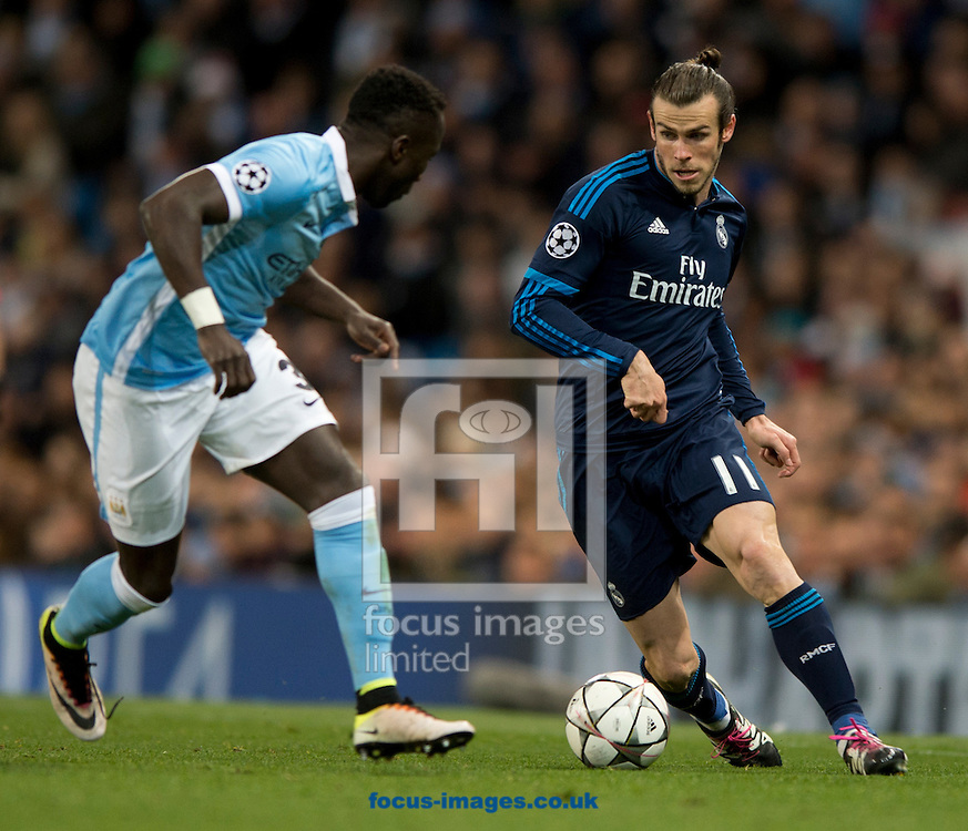 Gareth Bale of Real Madrid (right) looks to find a way past Bacary Sagna of Manchester City during the UEFA Champions League match at the Etihad Stadium, Manchester<br /> Picture by Russell Hart/Focus Images Ltd 07791 688 420<br /> 26/04/2016
