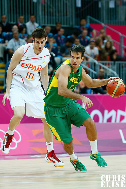 06 August 2012: Brazil Marcelo Machado drives past Spain Victor Claver during 88-82 Team Brazil victory over Team Spain, during the men's basketball preliminary, at the Basketball Arena, in London, Great Britain.