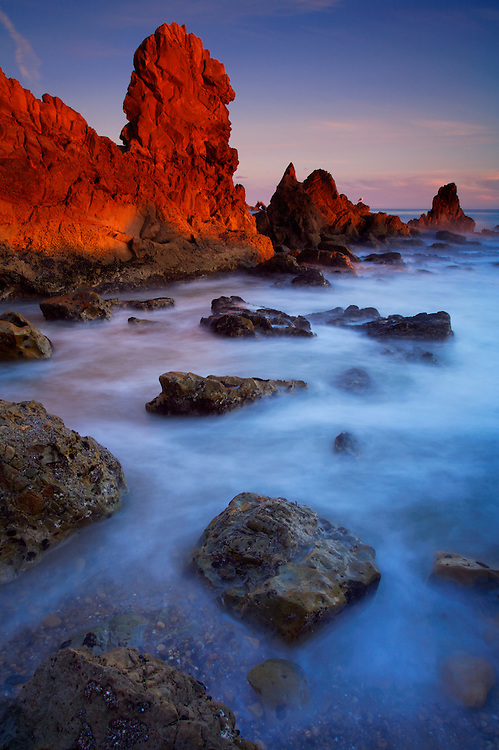 Rock formations, boulders and waves at late afternoon in Corona Del Mar, CA.