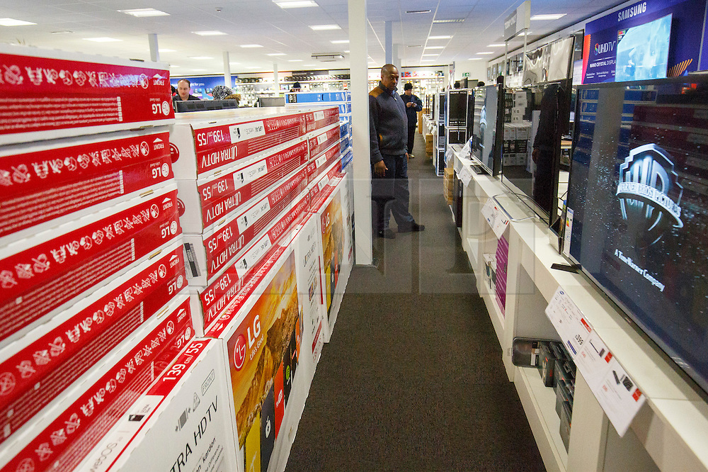 © Licensed to London News Pictures. 26/11/2015. London, UK. Black Friday shoppers looking at reduced televisions at a Currys PC World store in Tottenham Hale, north London on Friday, 27 November 2015. Photo credit: Tolga Akmen/LNP