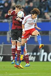 04.12.2011, Imtech Arena, Hamburg, GER, 1. FBL, Hamburger SV (GER) vs 1. FC Nuernberg (GER), im Bild Heung Min Son(Hamburg #15) versucht sich gegen Philipp Wollscheid (Nuernberg #38) durchzusetzen // during match at Imtech Arena 2011/12/04,HamburgEXPA Pictures © 2011, PhotoCredit: EXPA/ nph/ Witke..***** ATTENTION - OUT OF GER, CRO *****