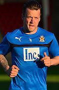 Cambridge's Josh Coulson warms up during the Sky Bet League 2 match between Cheltenham Town and Cambridge United at Whaddon Road, Cheltenham, England on 14 April 2015. Photo by Alan Franklin.