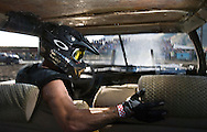 NEWS&GUIDE PHOTO / PRICE CHAMBERS.Shaun King braces for impact as a remote camera captures what it's like inside a demolition derby car during the second heat of the event.