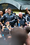 Richie McCaw and Graham Henry of the New Zealand All Blacks, 2011 Rugby World Cup champions, parade through the streets of Wellington. Rain and strong wind wasn't enough to deter Wellington locals from welcoming their heroes.