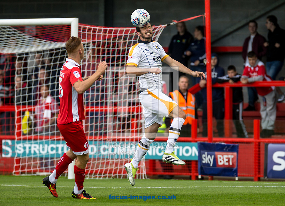 Gavin Gunning of Port Vale heads clear during the Sky Bet League 2 match at  Checkatrade.com Stadium, Crawley<br /> Picture by Liam McAvoy/Focus Images Ltd 07413 543156<br /> 05/08/2017