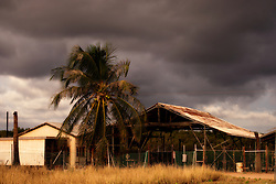 Storms build behind the old Paspaley shed on Dampier Terrace, Broome in the Kimberley wet season.