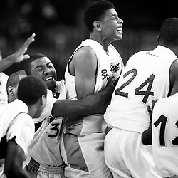 Kyle Green | The Roanoke Times<br /> March 10, 2011 Brunswick High School swarm the court after defeating Waynesboro High School during the Group AA Division 3 Boys semi final game at the 2011 VHSL basketball championships held at the Siegel Center in Richmond, Virginia. Brunswick defeated Waynesboro 55-48.