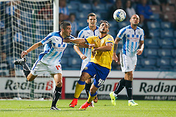 Andy Delort of Wigan is challenged by Conor Coady of Huddersfield - Photo mandatory by-line: Rogan Thomson/JMP - 07966 386802 - 16/09/2014 - SPORT - FOOTBALL - Huddersfield, England - The John Smith's Stadium - Huddersfield Town v Wigan Athletic - Sky Bet Championship.