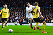 Leeds United midfielder Jack Harrison (22) is fouled during the EFL Sky Bet Championship match between Leeds United and Millwall at Elland Road, Leeds, England on 28 January 2020.
