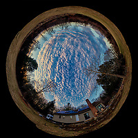 Inverse Little Planet Panorama of Late Afternoon Winter Clouds and Sky Over New Jersey. Composite of 12 portrait images taken with a Nikon D810a camera and 14-24 mm f/2.8 zoom lens (ISO 200, 14 mm, f/8, 1/100 sec). Raw images processed with Capture One Pro, Photoshop CC, and AutoGiga Pan Promo.