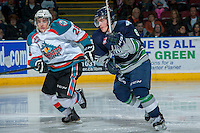 KELOWNA, CANADA - APRIL 5: Scott Eansor #8 of the Seattle Thunderbirds checks Joe Gatenby #28 of the Kelowna Rockets on April 5, 2014 during Game 2 of the second round of WHL Playoffs at Prospera Place in Kelowna, British Columbia, Canada.   (Photo by Marissa Baecker/Getty Images)  *** Local Caption *** Scott Eansor ;Joe Gatenby;