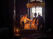 "14 MARCH 2105 - SIEM REAP, SIEM REAP, CAMBODIA: A Buddhist lay woman sets up a prayer room in Bayon, one of the temples in Angkor Thom, a part of the Angkor Wat complex. Bayon was built in 12th or 13th century CE. The area known as ""Angkor Wat"" is a sprawling collection of archeological ruins and temples. The area was developed by ancient Khmer (Cambodian) Kings starting as early as 1150 CE and renovated and expanded around 1180CE by Jayavarman VII. Angkor Wat is now considered the seventh wonder of the world and is Cambodia's most important tourist attraction.   PHOTO BY JACK KURTZ"