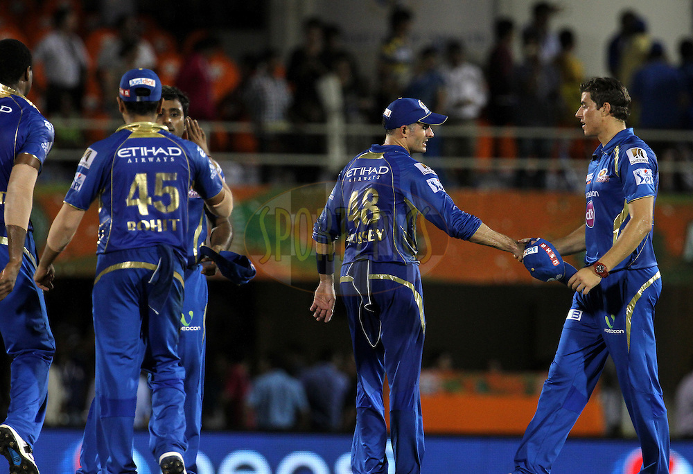Players shake hands after the eliminator match of the Pepsi Indian Premier League Season 2014 between the Chennai Superkings and the Mumbai Indians held at the Brabourne Stadium, Mumbai, India on the 28th May  2014<br /> <br /> Photo by Vipin Pawar / IPL / SPORTZPICS<br /> <br /> <br /> <br /> Image use subject to terms and conditions which can be found here:  http://sportzpics.photoshelter.com/gallery/Pepsi-IPL-Image-terms-and-conditions/G00004VW1IVJ.gB0/C0000TScjhBM6ikg