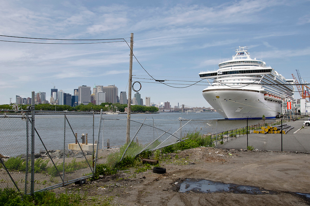 A cruise ferry waiting for its next trip with Manhattan skyline in the background, Red Hook, Brooklyn