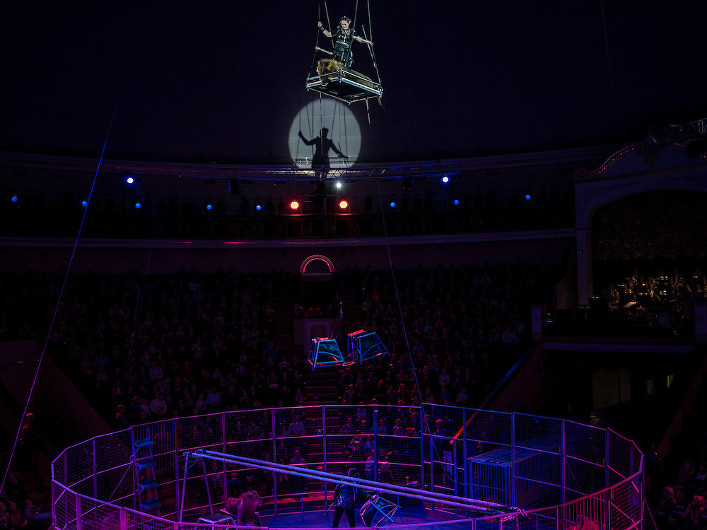 """Lion tamers peform at the Belarus State Circus during a show called """"Africa!?!"""" on Wednesday, November 25, 2015 in Minsk, Belarus."""