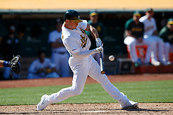 OAKLAND, CA - JULY 28:  Matt Chapman #26 of the Oakland Athletics at bat against the Texas Rangers during the ninth inning at the RingCentral Coliseum on July 28, 2019 in Oakland, California. The Oakland Athletics defeated the Texas Rangers 6-5. (Photo by Jason O. Watson/Getty Images) *** Local Caption *** Matt Chapman