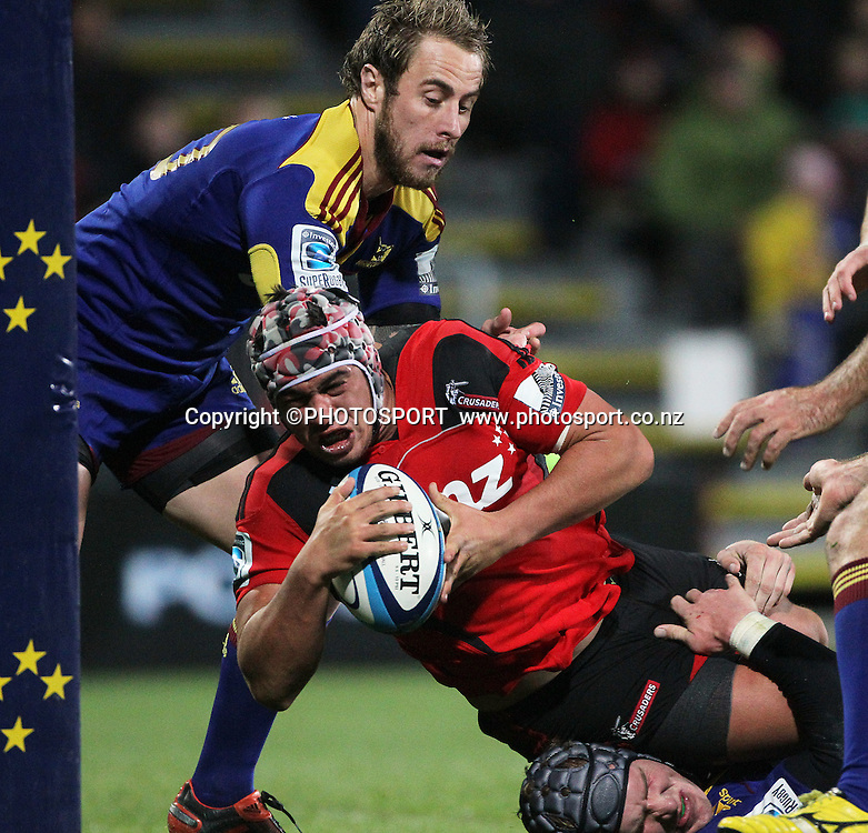 Quentin MacDonald in the tackle of Otago's Jimmy Cowen. Super Rugby game between the Crusaders and the Highlanders. The new AMI Christchurch Stadium at Rugby League Park, Friday 01 June 2012. Photo : Joseph Johnson / photosport.co.nz