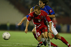 BELGRADE, SERBIA & MONTENEGRO - Wednesday, August 20, 2003: Wales' Craig Bellamy and Serbia & Montenegro's Goran Gavrancic during the UEFA European Championship qualifying match at the Red Star Stadium. (Pic by David Rawcliffe/Propaganda)
