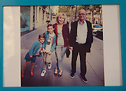 March 6, 2015, Paris, France. A photo in the apartment of Georges and Maryse  Wolinski, showing the assassinated cartoonist Georges Wolinski (1934 –2015), Maryse Wolinski (1943, Algiers) and their grand children. Georges Wolinski and Maryse Wolinski were married and had lived for 47 years together. Two month after the death of Georges Wolinski, the apartment is full of souvenirs and notes, attesting a half-century-long love affair. Georges Wolinski was 80 years old when he was murdered by 2 French jihadists, he was one of the 12 victims of the massacre in the Charlie Hebdo offices on January 7, 2015 in Paris. Charlie Hebdo published caricatures of Mohammed, considered blasphemous by some Muslims. During his life, Georges Wolinski defended freedom, secularism and humour and was one of the major political cartoonists in France. Photo: Steven Wassenaar.