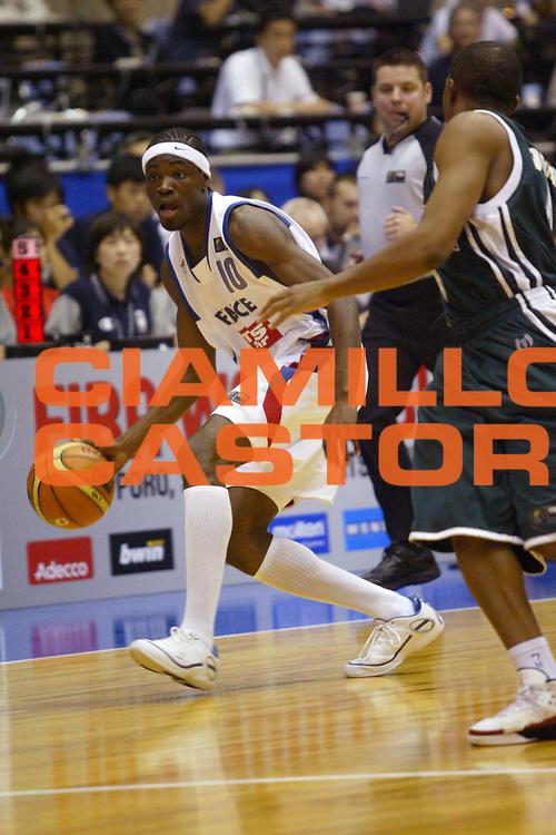 DESCRIZIONE : Sendai Giappone Japan Men World Championship 2006 Campionati Mondiali France-Nigeria <br /> GIOCATORE : Bokolo <br /> SQUADRA : France Francia <br /> EVENTO : Sendai Giappone Japan Men World Championship 2006 Campionato Mondiale France-Nigeria <br /> GARA : France Nigeria Francia Nigeria <br /> DATA : 21/08/2006 <br /> CATEGORIA : Palleggio <br /> SPORT : Pallacanestro <br /> AUTORE : Agenzia Ciamillo-Castoria/M.Metlas <br /> Galleria : Japan World Championship 2006<br /> Fotonotizia : Sendai Giappone Japan Men World Championship 2006 Campionati Mondiali France-Nigeria <br /> Predefinita :