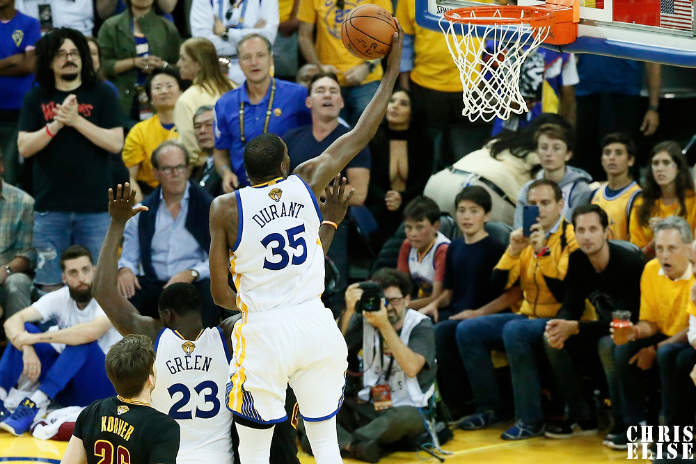 12 June 2017: Golden State Warriors forward Kevin Durant (35) goes for the layup past Cleveland Cavaliers forward LeBron James (23) during the Golden State Warriors 129-120 victory over the Cleveland Cavaliers, in game 5 of the 2017 NBA Finals, at the Oracle Arena, Oakland, California, USA.