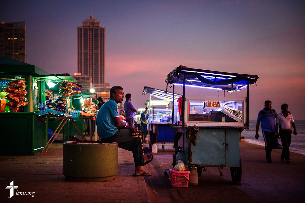 Food vendors wait for customers during sunset on the promenade at Galle Face Green on Thursday, Jan. 18, 2018, in Colombo, Sri Lanka. LCMS Communications/ Erik M. Lunsford