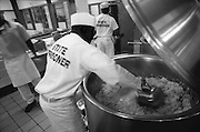 State Prisoners work in the prison kitchen at a correctional facility in Georgia.