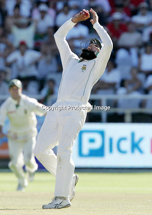 Hashim Amla catches Andrew Strauss for 45 from the bowling of Paul Harris  to take the second wicket during the 4th day of the third test match between South Africa and England held at Newlands Cricket Ground in Cape Town on the 6th January 2010.Photo by: Ron Gaunt/ SPORTZPICS