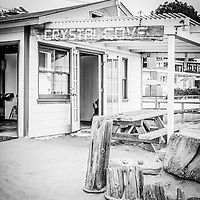 Crystal Cove cottage #46 and sign black and white photo in Laguna Beach California. The famous Cottage 46 is an now an exhibitors center operated by the Crystal Cove Alliance. The cottage is part of the Crystal Cove Historic District in Orange County Southern California.