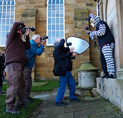 © Licensed to London News Pictures. <br /> 01/11/2014. <br /> <br /> Whitby, Yorkshire, United Kingdom<br /> <br /> Photographers take pictures of a  court jester during the Whitby Goth Weekend. <br /> <br /> The event this weekend brings together thousands of extravagantly dressed followers of Victoriana, Steampunk, Cybergoth and Romanticism who all visit the town to take part in celebrating Gothic culture. This weekend marks the 20th anniversary since the event was started by local woman Jo Hampshire.<br /> <br /> Photo credit : Ian Forsyth/LNP