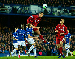 LIVERPOOL, ENGLAND - Sunday, March 3, 2019: Liverpool's Virgil van Dijk and Everton's Cenk Tosun during the FA Premier League match between Everton FC and Liverpool FC, the 233rd Merseyside Derby, at Goodison Park. (Pic by Laura Malkin/Propaganda)