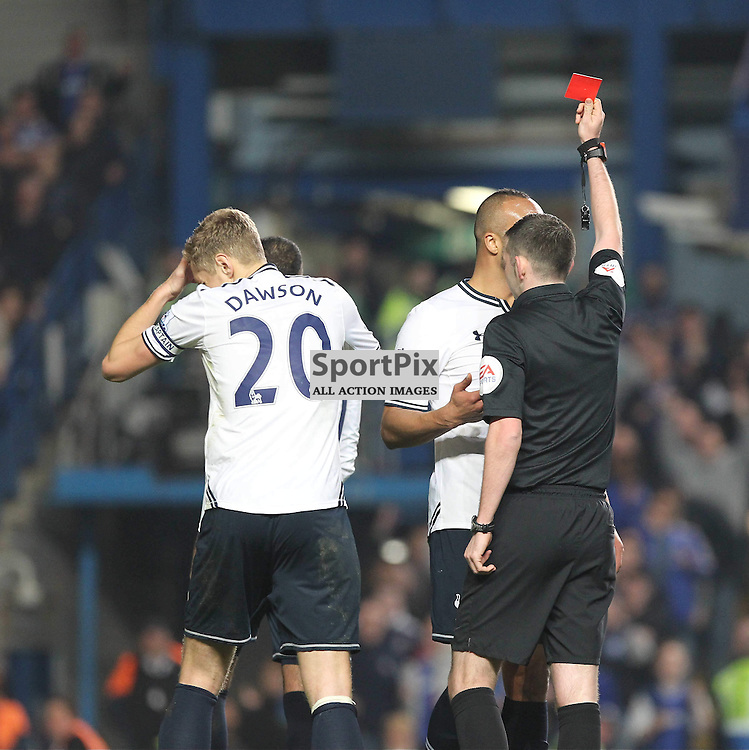 Referee Michael Oliver shows a red card to Tottenham's Michael Dawson during the English Barclays Premiership match between Chelsea FC and Tottenham Hotspur FC at Stamford Bridge, London, 8th March 2014 © Phil Duncan | SportPix.org.uk