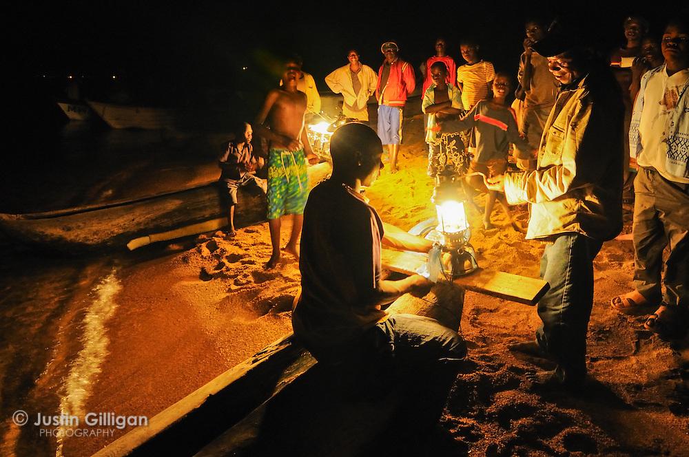 Fishers prepare for a night of usipa fishing on the shore of Senga Bay, Lake Malawi, Malawi.
