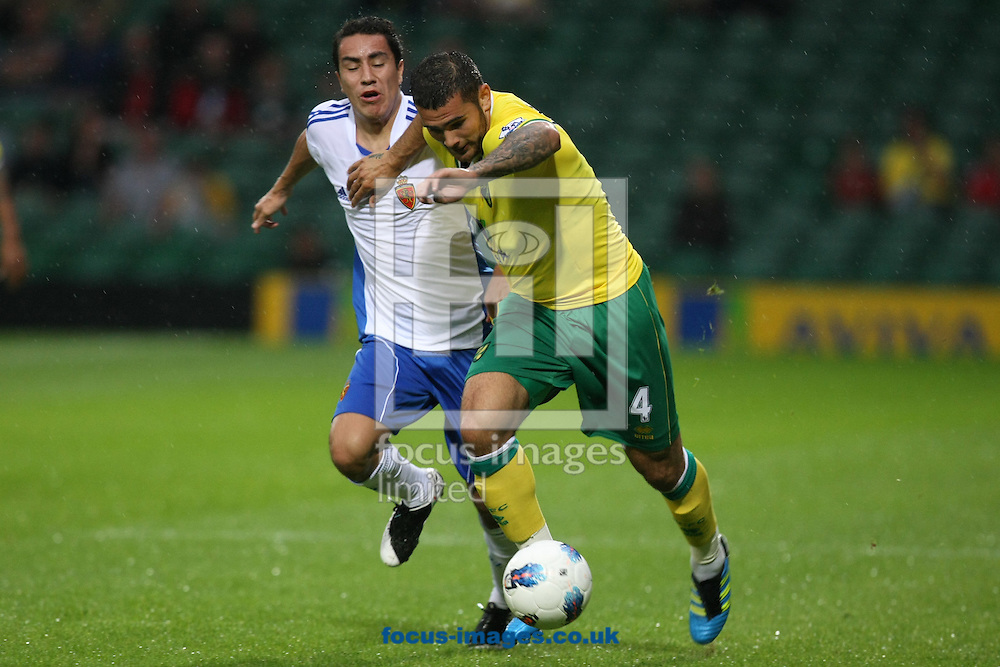 Bradley Johnson of Norwich and Efrain Juarez of Real Zaragoza during a pre season friendly at Carrow Road stadium, Norwich...Picture by Paul Chesterton/Focus Images Ltd.  07904 640267.3/8/11