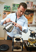 The London Coffee Festival <br /> Truman Brewery, Brick Lane, London, Great Britain <br /> 6th April 2017 <br /> <br /> David Cutler - head of training at Lavazza Coffee UK pouring a coffee for visitors at the London Coffee Festival <br /> <br /> Photograph by Elliott Franks <br /> Image licensed to Elliott Franks Photography Services
