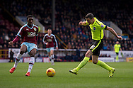Jamie Murphy of Brighton and Hove Albion (right) shoots at goal during the Sky Bet Championship match at Turf Moor, Burnley<br /> Picture by Russell Hart/Focus Images Ltd 07791 688 420<br /> 22/11/2015