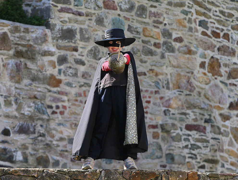 """28/04/2013. REPRO FREE. Young Zorro, Thomas O Grady age 7, taking to the streets of Wexford town ahead of the 'Zorrfest' which will take place on Saturday, May 4 across Wexford town, the ancestral home of William Lamport otherwise known as 'El Zorro' – Photograph Patrick Browne<br /> <br /> APRIL 28, 2013.<br />  <br /> FREE TO USE IMAGES FROM PATRICK BROWNE – 086 2515700<br /> <br />  Zorrofest<br /> Wexford Celebrates Roots of Zorro with Mexican Festival<br />  <br /> On Saturday May 4 Zorrofest in Wexford will celebrate the life and legend of a real-life 'Irish Zorro' - 17th-century Wexfordman William Lamport, this  pirate, soldier, spy and would-be revolutionary a rebellious romantic rascal and swashbuckling righter of wrongs, was Wexfordman and also the writer of the first independence proclamation of the Americas.  A statue of """"Guillén de Lampart"""" - as he is known in Mexico - guards the tomb of their revolutionary heroes and Independence Monument to this day.<br />  <br /> His story has been hidden for centuries in the Mexican Inquisition's archives, and rediscovered only in the last quarter of the last century.  He was an """"Irish Zorro"""" who led a life of adventure as fantastic as any fiction, and shaped the Mexican folk-culture from which these stories drew their inspiration.Imprisoned for years by the Inquisition in New Spain for consorting with a native shaman, he was also a prolific writer and thinker, using bed sheets for paper and candle soot for ink. After a brilliant escape and call to revolt, he cheated his own death at the stake. <br />  <br /> """"Wexicans"""" are celebrating both fiction and amazing history this May bank holiday weekend, with a festival in honour of both man and myth at Zorrofest! Masked heroes and a carnival of colourful creatures will jump forth from the pages of literary legend and folk history, and onto to the streets of Wexford. International guests will offer unprecedented intellectual insights to his heritage, and share wonderful c"""