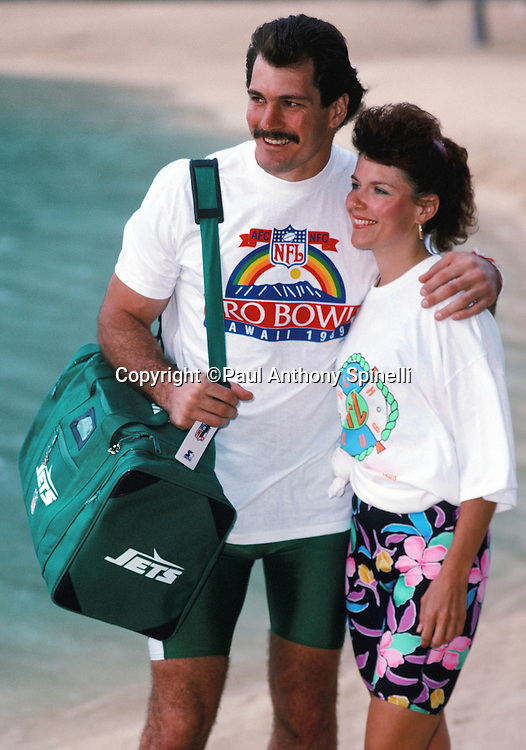 The American Football Conference New York Jets tight end Mickey Shuler poses for a photo with his wife at Waikiki Beach during the week before the 1989 NFL Pro Bowl football game against the National Football Conference on Jan. 24, 1989 in Honolulu. The NFC won the game 34-3. (©Paul Anthony Spinelli)