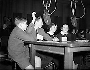 """15/02/1953<br /> 02/15/1953<br /> 15 February 1953<br /> Radio Eireann """"Question Time"""" general-knowledge quiz show trial at the Phoenix Hall, Dublin. One of the teams in action."""